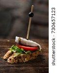 tapas on crusty bread  ...   Shutterstock . vector #730657123