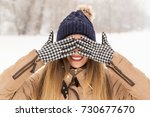 beautiful woman wearing a warm... | Shutterstock . vector #730677670