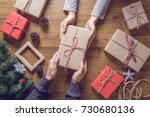gives a gift christmas presents ... | Shutterstock . vector #730680136