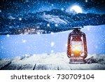 christmas lamp on wooden table... | Shutterstock . vector #730709104