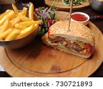 cheese burger with pommes | Shutterstock . vector #730721893
