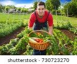 young farmer holding wicker... | Shutterstock . vector #730723270