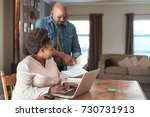 smiling african couple paying... | Shutterstock . vector #730731913
