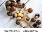 close up macadamia nuts on ... | Shutterstock . vector #730733596