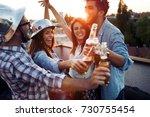 happy cheerful friends spending ...   Shutterstock . vector #730755454