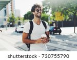 attractive young man with dark... | Shutterstock . vector #730755790