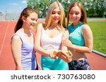 girls running on stadium   Shutterstock . vector #730763080