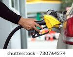 man refuel of car in patrol... | Shutterstock . vector #730764274