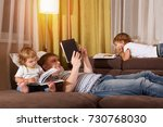 father and children are reading ...   Shutterstock . vector #730768030