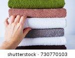 female hand take stack bath...   Shutterstock . vector #730770103