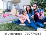 Family With American Flags And...