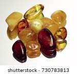 pieces of colorful amber on a... | Shutterstock . vector #730783813
