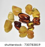 pieces of colorful amber on a... | Shutterstock . vector #730783819