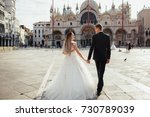 bride and groom hold their... | Shutterstock . vector #730789039