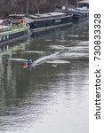 A Pair Of Rowers Row On Calm...