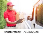 parcel delivery man stand... | Shutterstock . vector #730839028