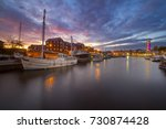 a white masted vessel is moored ... | Shutterstock . vector #730874428