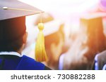 shot of graduation hats during... | Shutterstock . vector #730882288