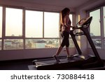 young asian woman exercising on ... | Shutterstock . vector #730884418