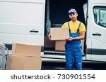 workman or courier holds carton ...   Shutterstock . vector #730901554