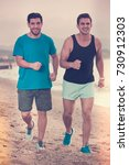 adult men are jogging together... | Shutterstock . vector #730912303