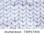 Small photo of background textile white knitted plaid of thick woolen yarn / white knitted plaid