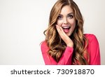 woman  happy and surprised... | Shutterstock . vector #730918870