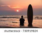 silhouette of surfer man... | Shutterstock . vector #730919824