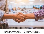 close up two male shaking hands   Shutterstock . vector #730922308