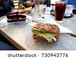 having breakfast in a cafe. | Shutterstock . vector #730943776