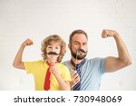funny man and kid with fake... | Shutterstock . vector #730948069