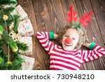 happy child wearing reindeer... | Shutterstock . vector #730948210