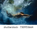 underwater shot of the young... | Shutterstock . vector #730953664