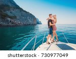 couple relaxing on a yacht at... | Shutterstock . vector #730977049