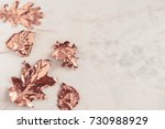 Stock photo autumn rose gold colored leaves creative flatlay on white marble background copy space for text 730988929