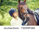 Young Beautiful Rider Woman In...