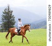 Young Woman Riding Sorrel Hors...