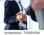 business men giving a handshake.... | Shutterstock . vector #731001928
