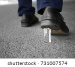 foot stuck into chewing gum on... | Shutterstock . vector #731007574