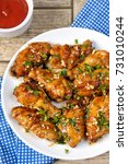 Small photo of Fried chicken wings in ginger garlic marinade with herbs