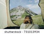 Small photo of Female vacationer camper in tent Looking At mountain view in Montenegro