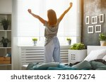 young happy woman woke up in... | Shutterstock . vector #731067274