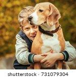 happy smiling boy hugs his best ... | Shutterstock . vector #731079304