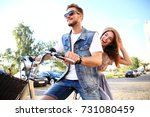 happy funny young couple riding ... | Shutterstock . vector #731080459