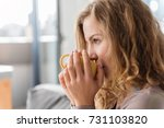 satisfied female enjoying cup... | Shutterstock . vector #731103820