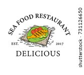 sea food restaurant logo... | Shutterstock .eps vector #731126650