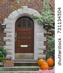 front door with pumpkins | Shutterstock . vector #731134504