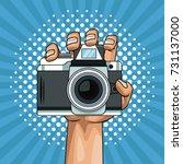hand holding camera pop art... | Shutterstock .eps vector #731137000