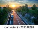 three white trucks driving on... | Shutterstock . vector #731148784