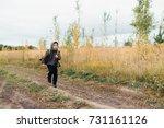 a boy runs along the path in... | Shutterstock . vector #731161126